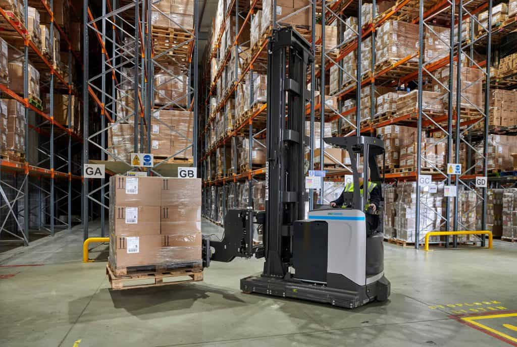 Warehouse showing racking and fork lift